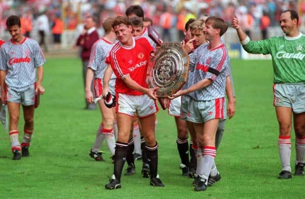 Liverpool's Ronnie Whelan and Manchester United's Steve Bruce with the Charity Sheild