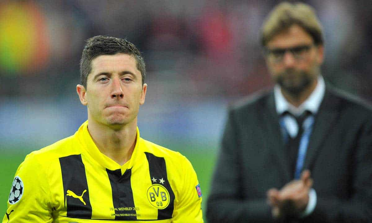 Picture by: Martin Rickett / PA Archive/Press Association Images Borussia Dortmund Robert Lewandowski looks dejected a he leaves the pitch past manager Jurgen Klopp after the UEFA Champions League Final at Wembley Stadium, London.