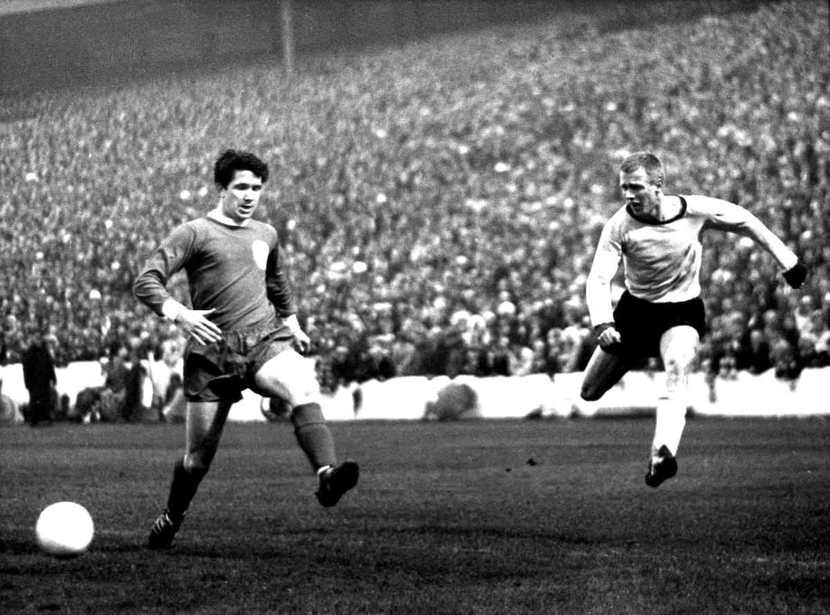 Borussia Dortmund's Siggi Held (right) gets in a cross despite the attention of Liverpool's Chris Lawler, 1966 final ( Witters/Witters/Press Association Images)