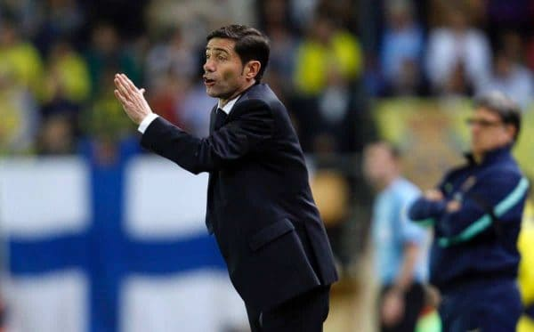 Villarreal's coach Marcelino Garcia Toral from Spain gestures to players during a Spanish La Liga soccer match against Barcelona at the Madrigal stadium in Villarreal, Spain, on Sunday, April 27, 2014. (AP Photo/Alberto Saiz)