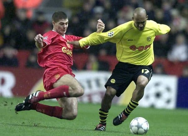 Liverpool's Steven Gerrard (left) tackles Dede of Borussia Dortmund, during the Champions League group B match at Anfield, Liverpool.  (Picture by: Phil Noble / PA Archive/Press Association Images)