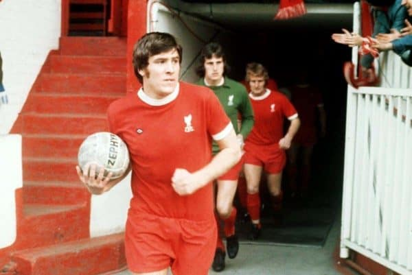 Emlyn Hughes, captain of Liverpool FC leads his side out at Anfield.