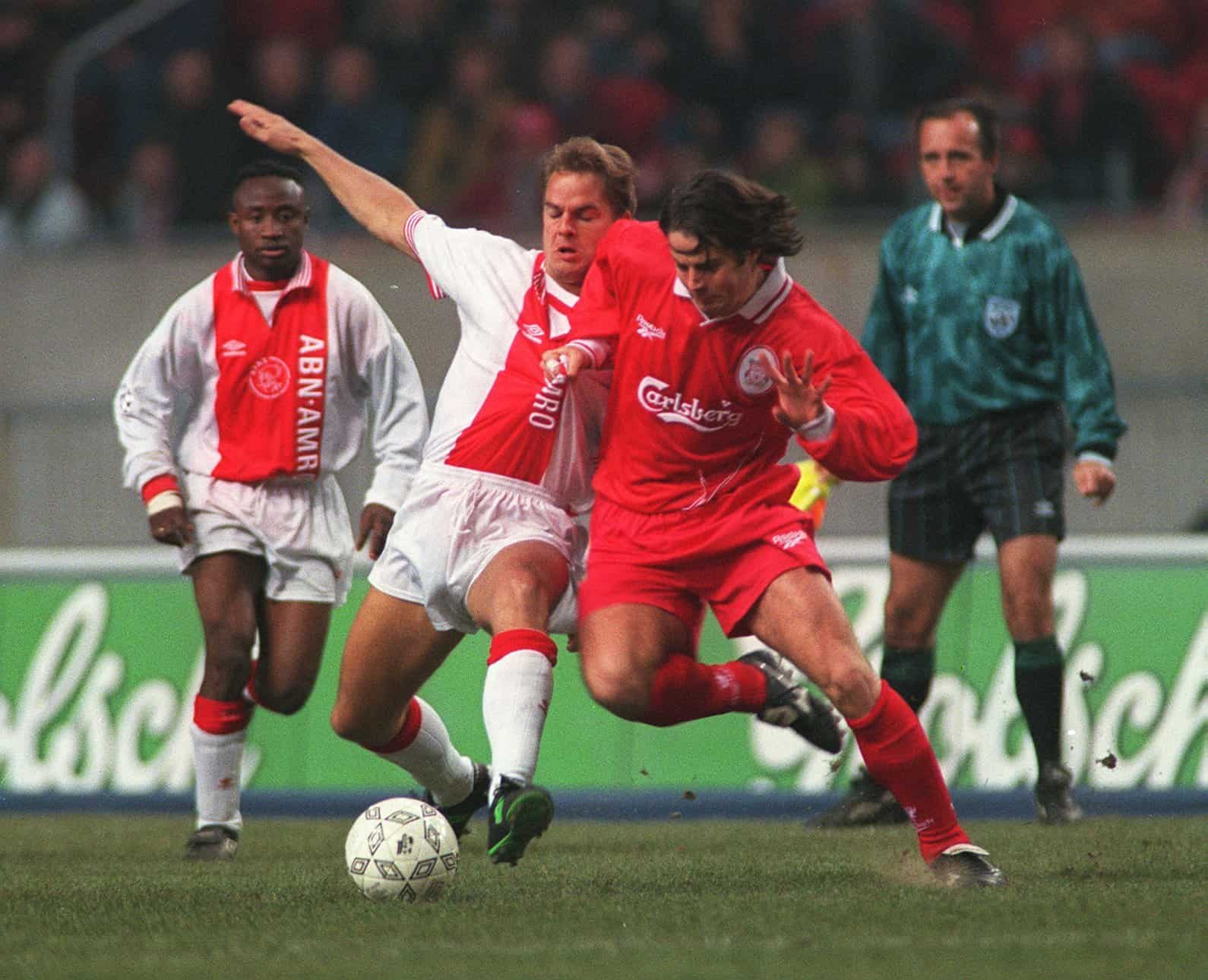 Frank De Boer, Ajax and Liverpool's Jamie Redknapp battle for the ball