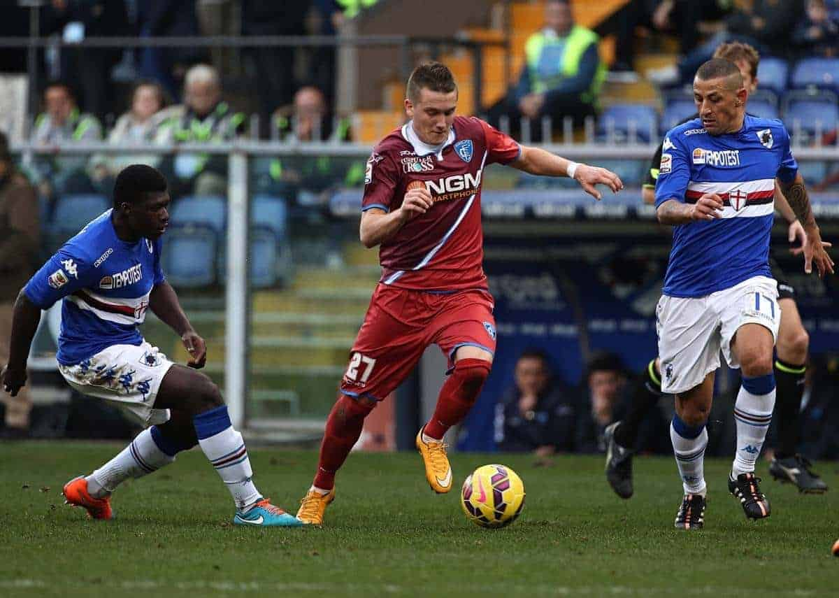 Empoli midfielder Piotr Zielinski, center, runs with the ball between Sampdoria midfielder Alfred Joseph Duncan, left, and defender Angelo Palombo during a Serie A soccer match between Sampdoria and Empoli, in Genoa, Italy, Sunday, Jan. 11, 2015. (AP Photo/Carlo Baroncini)
