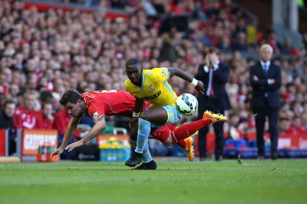 Liverpool's Dejan Lovren (left) and Crystal Palace's Pape N'Diaye Souare (right) battle for the ball during the Barclays Premier League match at Anfield, Liverpool. Saturday May 16, 2015. Photo: Peter Byrne/PA Wire.