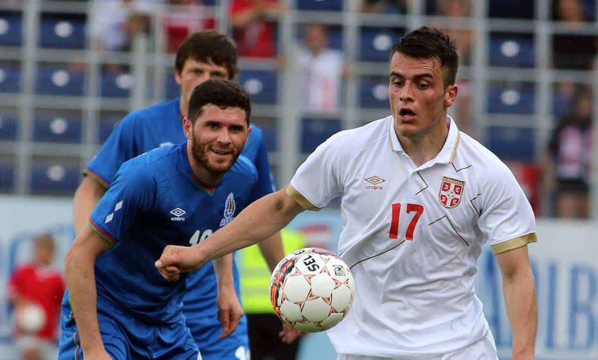 Serbia's Filip Kostic, right, challenges with Azerbaijan's Huseynov Javid, left, for the ball during a friendly soccer match between Serbia and Azerbaijan in St. Poelten, Austria, Sunday, June 7, 2015. (AP Photo/Ronald Zak)