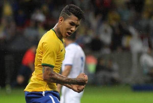 Brazil's Roberto Firmino celebrates after scoring a goal during a friendly soccer match against Honduras in Porto Alegre, Brazil, Wednesday, June 10, 2015. Brazil is preparing for the Copa America which begins Thursday in Chile. (AP Photo/Nabor Goulart)