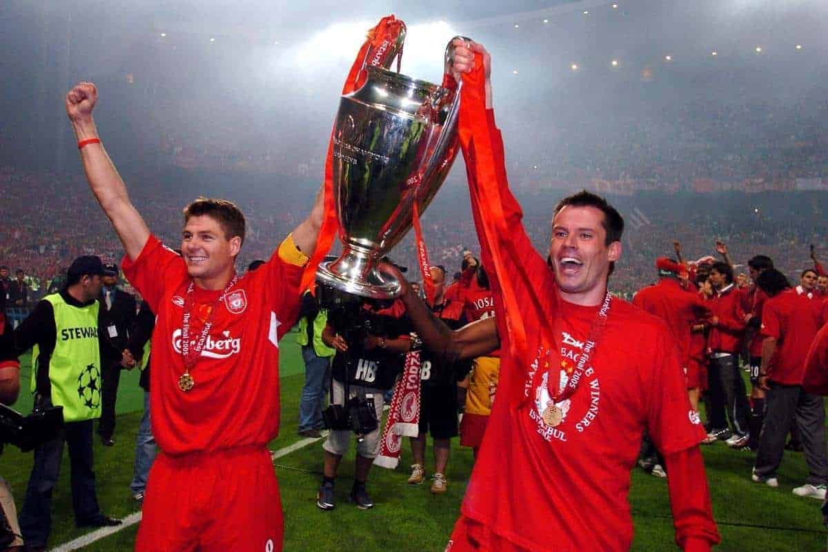 Liverpool's Steven Gerrard (l) and Jamie Carragher celebrate with the trophy