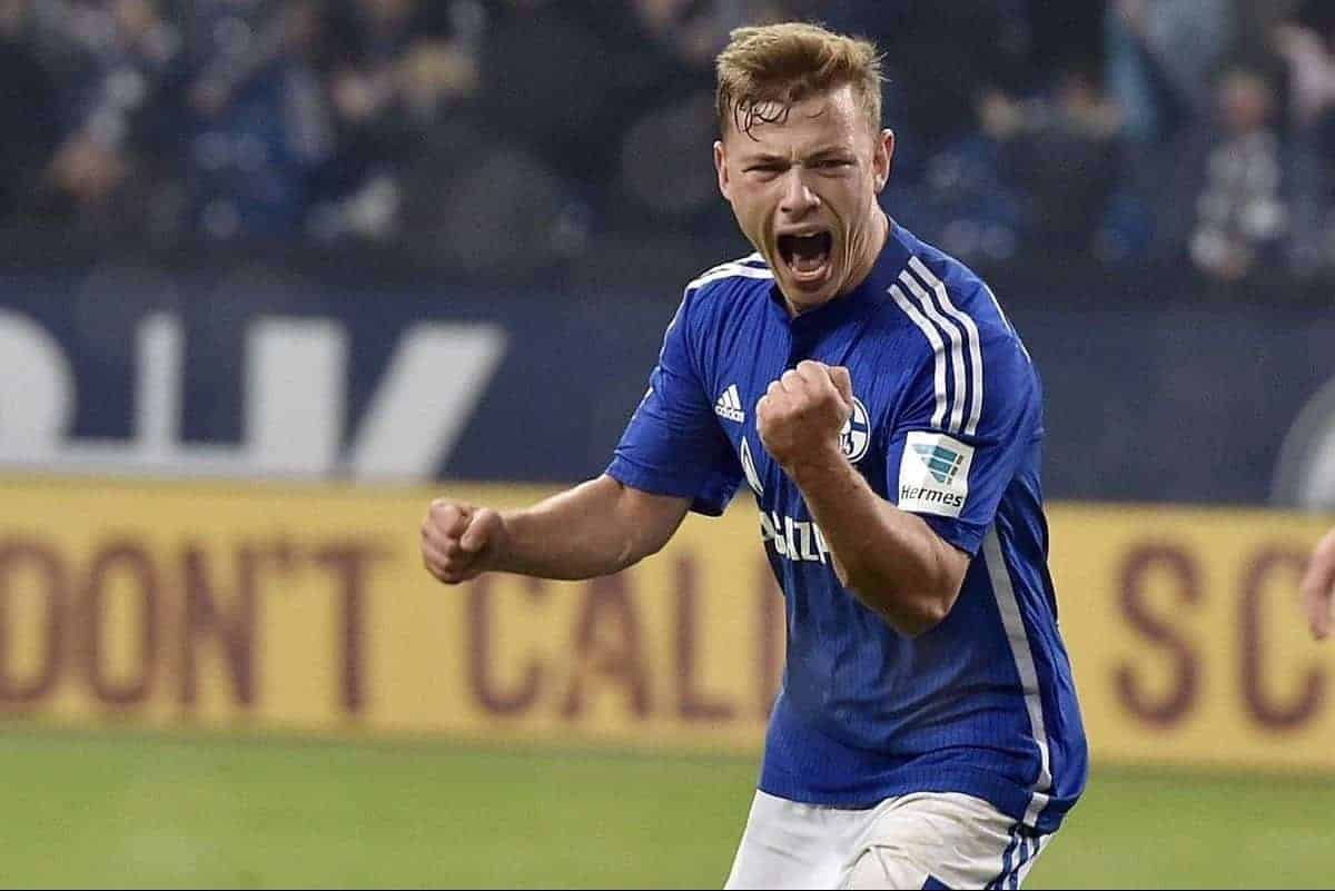 Schalke's Max Meyer, left, celebrates beside Berlin's Sebastian Langkamp after scoring the decisive goal in the very last minute of the German Bundesliga soccer match between FC Schalke 04 and Hertha BSC Berlin in Gelsenkirchen, Germany, Saturday, Oct. 17, 2015. Schalke defeated Berlin with 2-1. (AP Photo/Martin Meissner)
