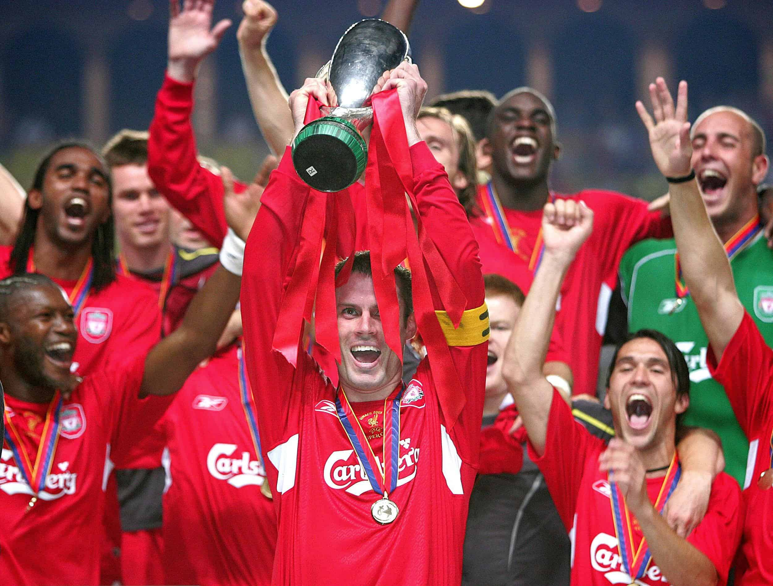 Liverpool captain Jamie Carragher (C) lifts the trophy after winning the UEFA Super Cup against Monaco at the Louis II Stadium in Monaco, Friday August 26, 2005. PRESS ASSOCIATION Photo: Martin Rickett/PA.