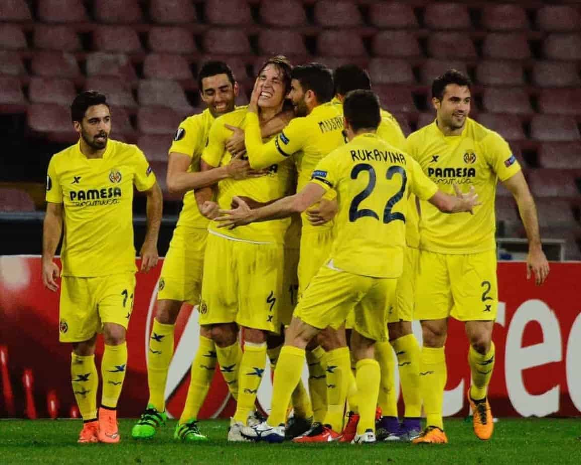 Villarreal's Tomas Pina, third from left, celebrates with teammates after scoring, during the Europa League, round of 32, second-leg soccer match between Napoli and Villareal, at the San Paolo stadium in Naples, Italy, Thursday, Feb. 25, 2016. (AP Photo/Salvatore Laporta)