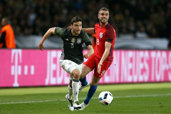 England's Jordan Henderson and Germany's Jonas Hector (left) in action during the International Friendly match at the Olympic Stadium, Berlin. PRESS ASSOCIATION Photo. Picture date: Saturday March 26, 2016. See PA story SOCCER Germany. Photo credit should read: Adam Davy/PA Wire.