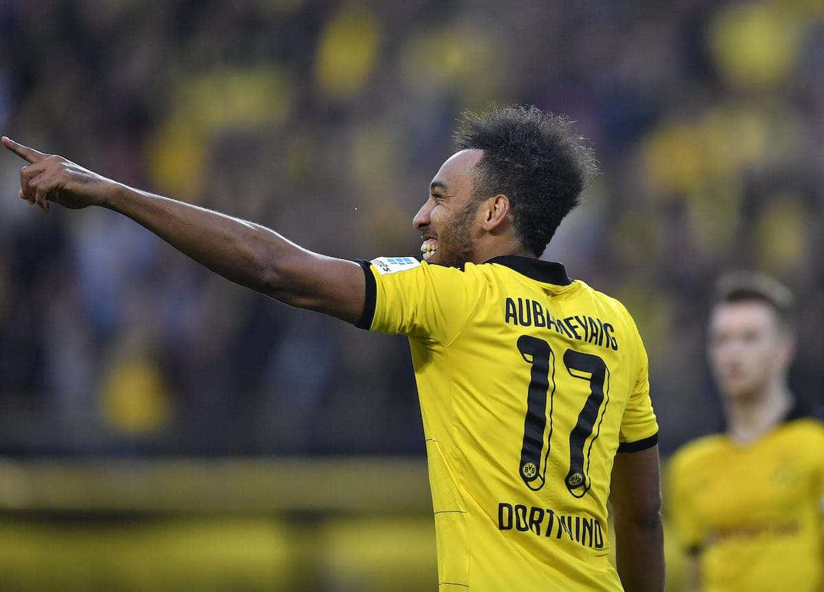 Dortmund's Pierre-Emerick Aubameyang celebrates after scoring during the German Bundesliga soccer match between Borussia Dortmund and Werder Bremen in Dortmund, Germany, Saturday, April 2, 2016. (AP Photo/Martin Meissner)