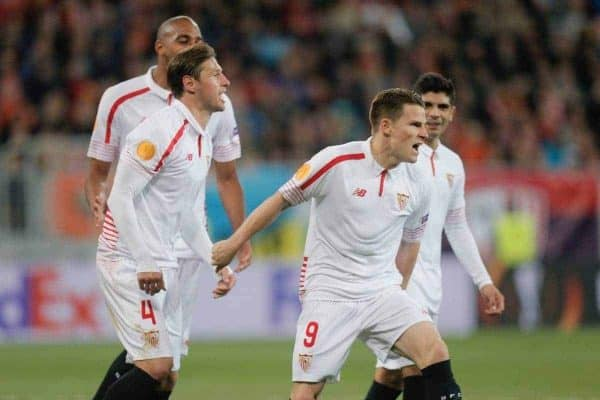 Sevilla's Kevin Gameiro, second right, celebrates scoring his side's second goal from a penalty during semifinal first leg of the Europa League soccer match, between FC Shakhtar Donetsk and Sevilla at Arena Lviv stadium in Lviv, western Ukraine, Thursday, April 28, 2016. (AP Photo/Efrem Lukatsky)