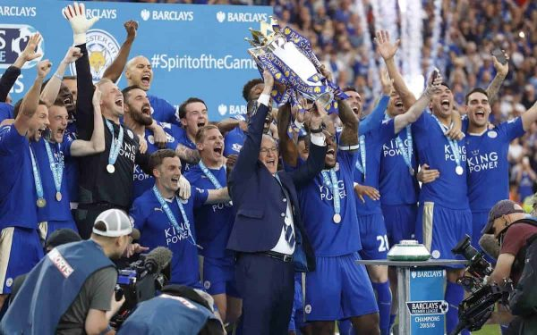 Leicester's team manager Claudio Ranieri and Leicester's Wes Morgan lift the trophy as Leicester City celebrate becoming the English Premier League soccer champions at King Power stadium in Leicester, England, Saturday, May 7, 2016.(AP Photo/Matt Dunham)