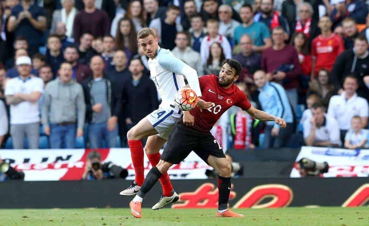 England's Jordan Henderson (left) and Turkey's Volkan Sen battle for the ball during the international friendly match at the Etihad Stadium, Manchester.