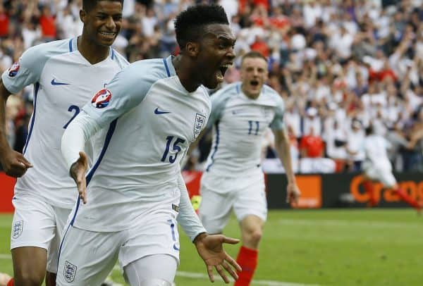 England's Daniel Sturridge, front, celebrates after scoring his side's second goal during the Euro 2016 Group B soccer match between England and Wales at the Bollaert stadium in Lens, France, Thursday, June 16, 2016. Behind are Marcus Rashford, left, and Jamie Vardy. (AP Photo/Kirsty Wigglesworth)