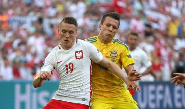 Poland's Piotr Zielinski (left) and Ukraine's Yevhen Konoplyanka battle for the ball. (Picture by: Nick Potts / EMPICS Sport)