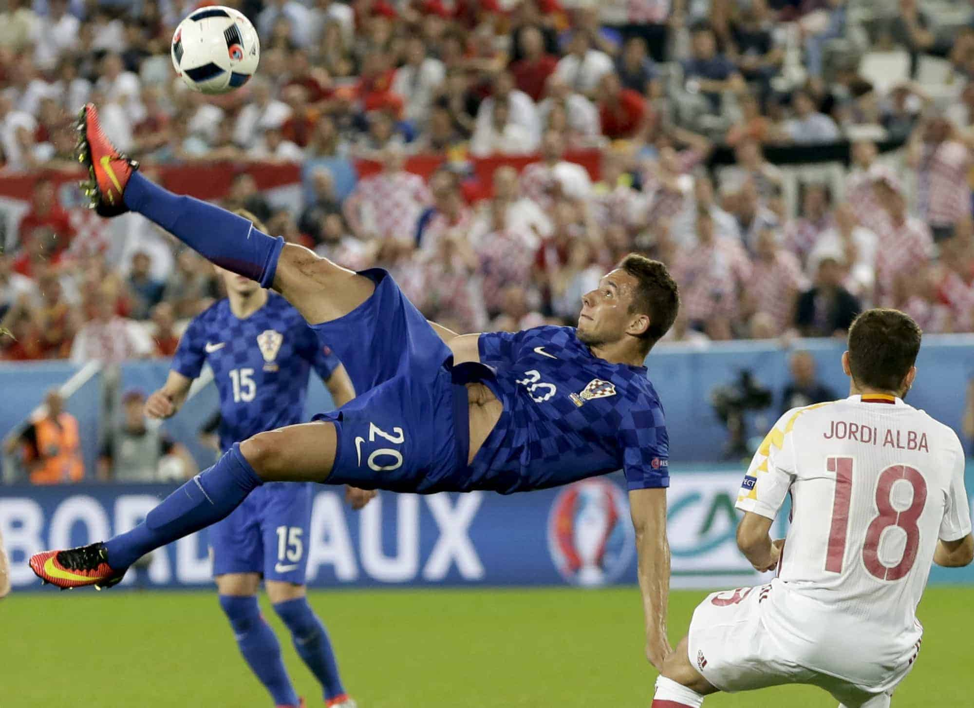 Croatia's Marko Pjaca goes for an overhead kick during the Euro 2016 Group D soccer match between Croatia and Spain at the Nouveau Stade in Bordeaux, France, Tuesday, June 21, 2016. (AP Photo/Petr David Josek)