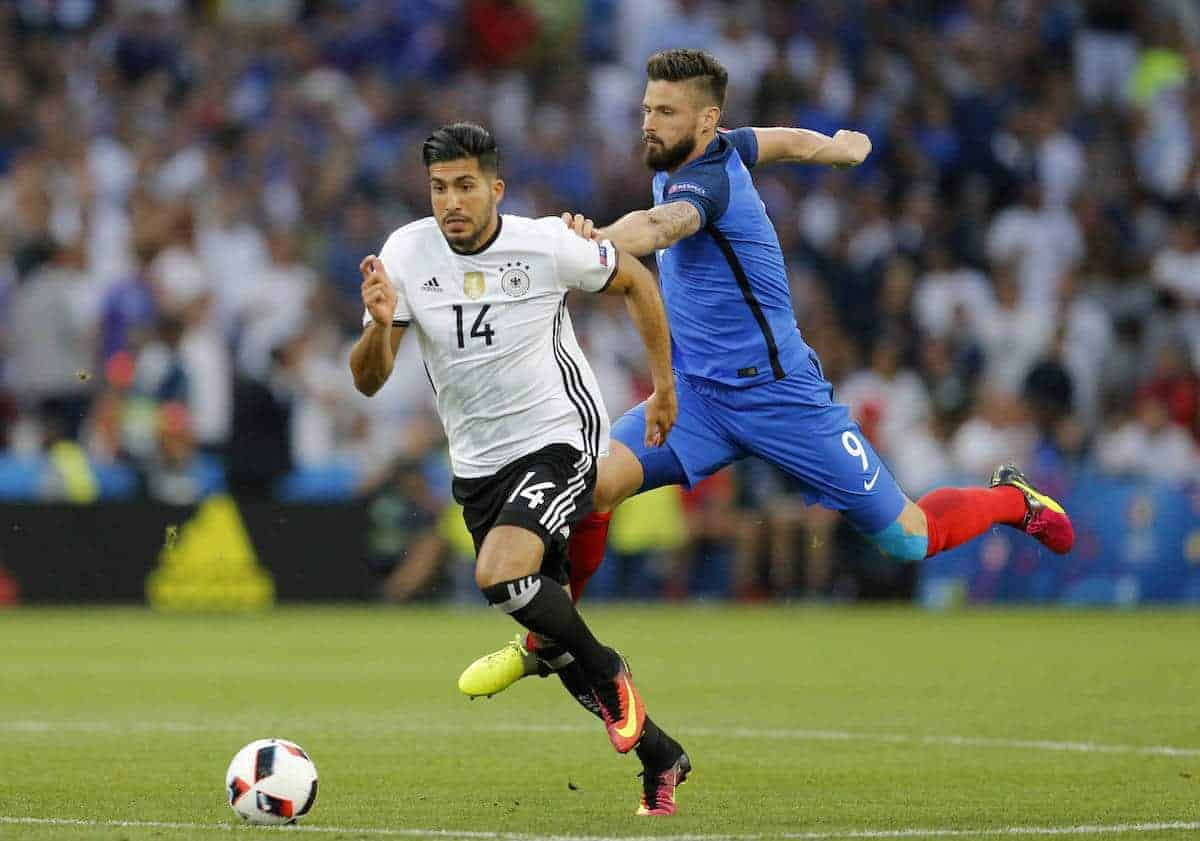 France's Olivier Giroud, right, holds Germany's Emre Can during the Euro 2016 semifinal soccer match between Germany and France, at the Velodrome stadium in Marseille, France, Thursday, July 7, 2016. (AP Photo/Michael Probst)