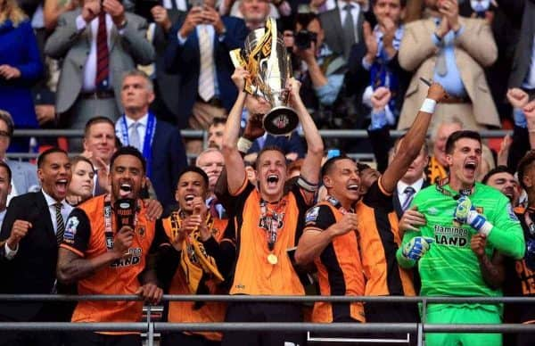 Hull City's Michael Dawson lifts the trophy after winning the Championship Play-Off Final