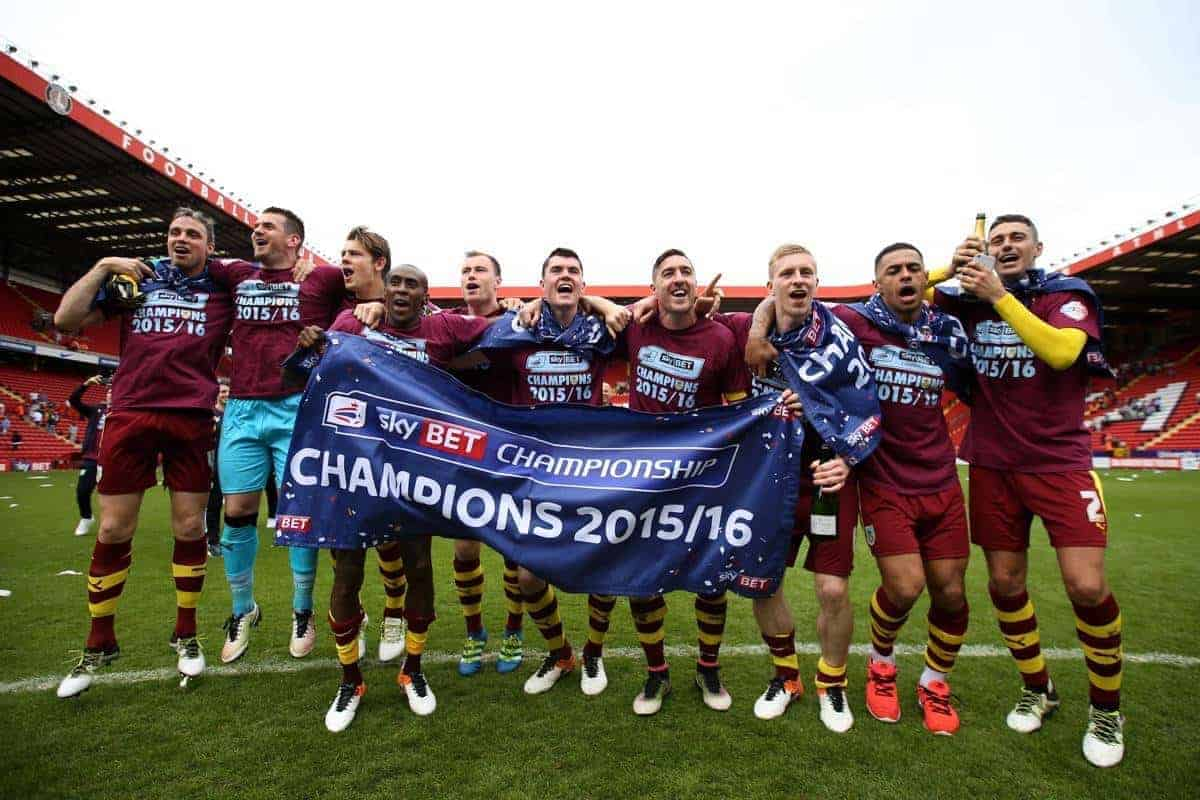 Burnley players celebrate victory and winning the league