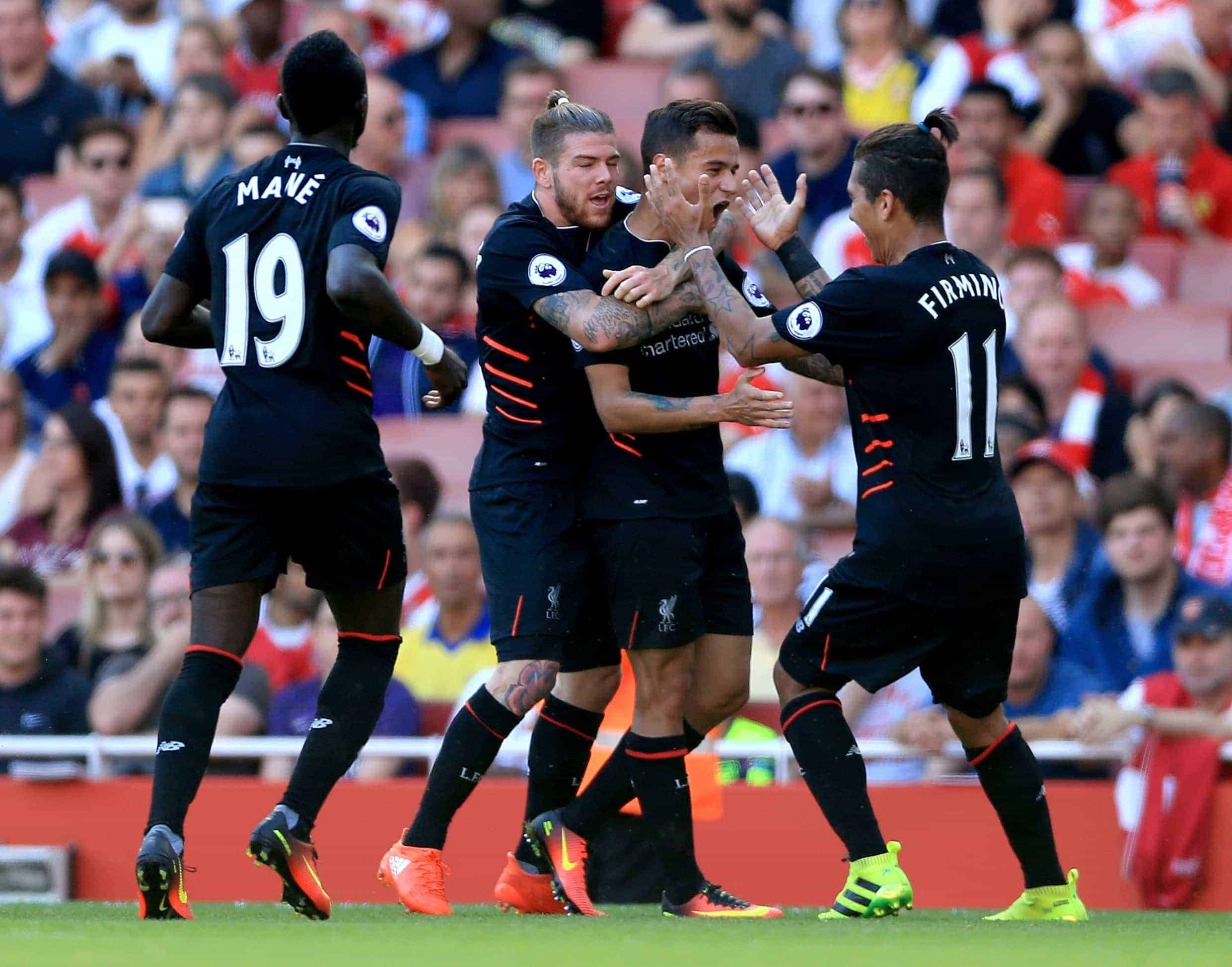 Picture by: Nigel French / EMPICS Sport Liverpool's Philippe Coutinho (second right) celebrates scoring his side's first goal of the game with team-mates