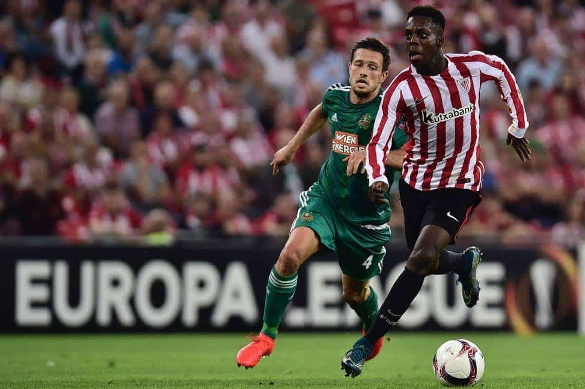 Athletic Bilbao's Inaki Williams, right, chase the ball with Rapid Wien's Thomas Schrammel during the Europa League Group F soccer match between Athletic Bilbao and Rapid Wien, at San Mames stadium, in Bilbao, northern Spain, Thursday, Sept. 29, 2016. Athletic Bilbao won 1-0.(AP Photo/Alvaro Barrientos)