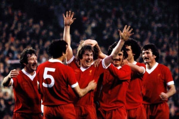 Liverpool's Kenny Dalglish (centre) is congratulated by his teammates after scoring the winning goal