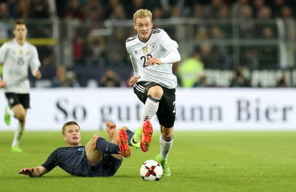 England's Eric Dier (left) and Germany's Julian Brandt (right) battle for the ball