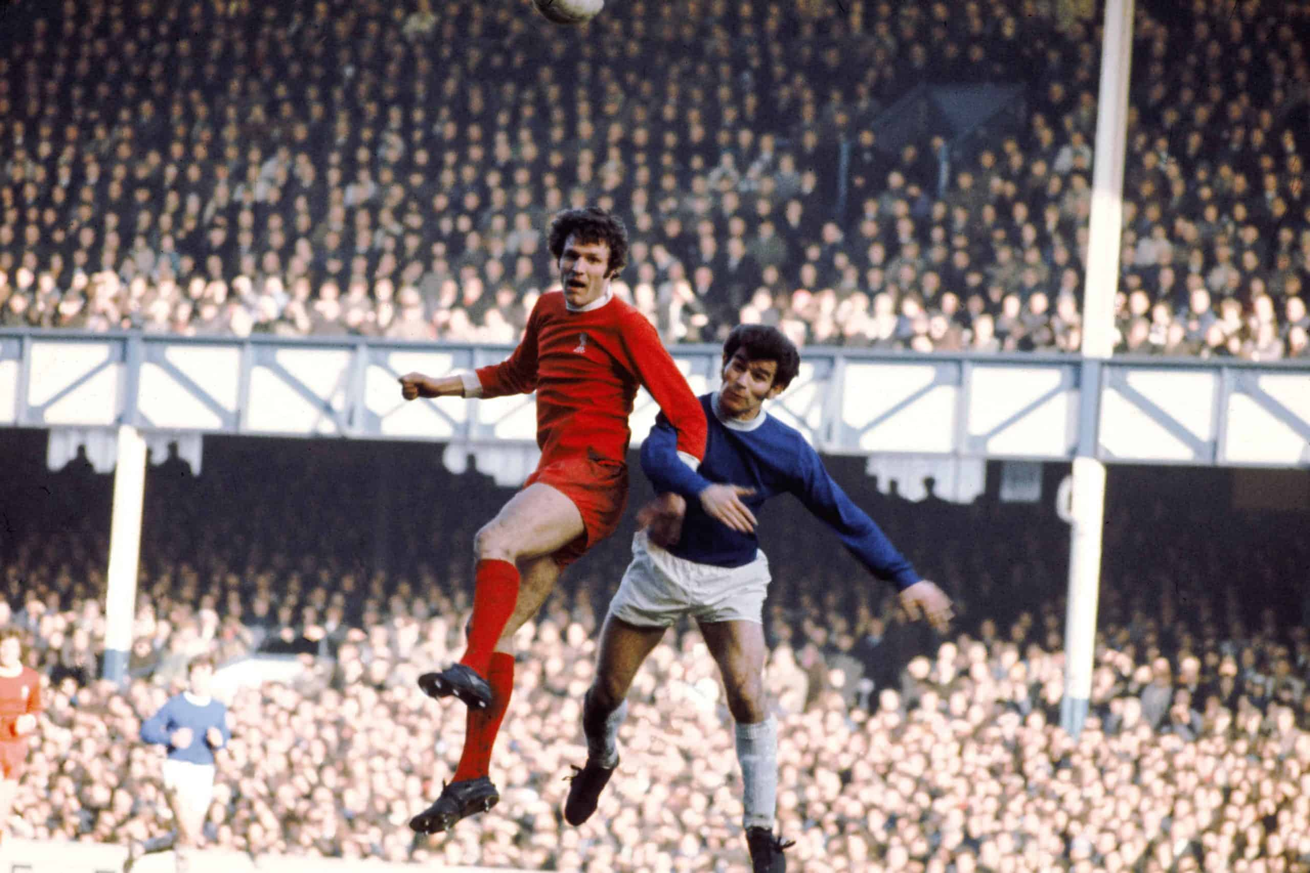 Liverpool's John Toshack (left) beats Everton's Henry Newton (right) in the air, 1972 ( Peter Robinson/EMPICS Sport)