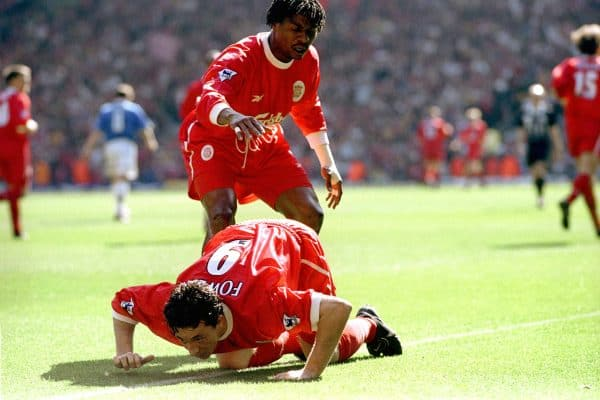 Liverpool's Rigobert Song (standing) congratulates Robbie Fowler after scoring their first goal as he pretends to snort cocaine from the touch line, after abuse from the Everton fans, 1999 (Neal Simpson/EMPICS Sport)