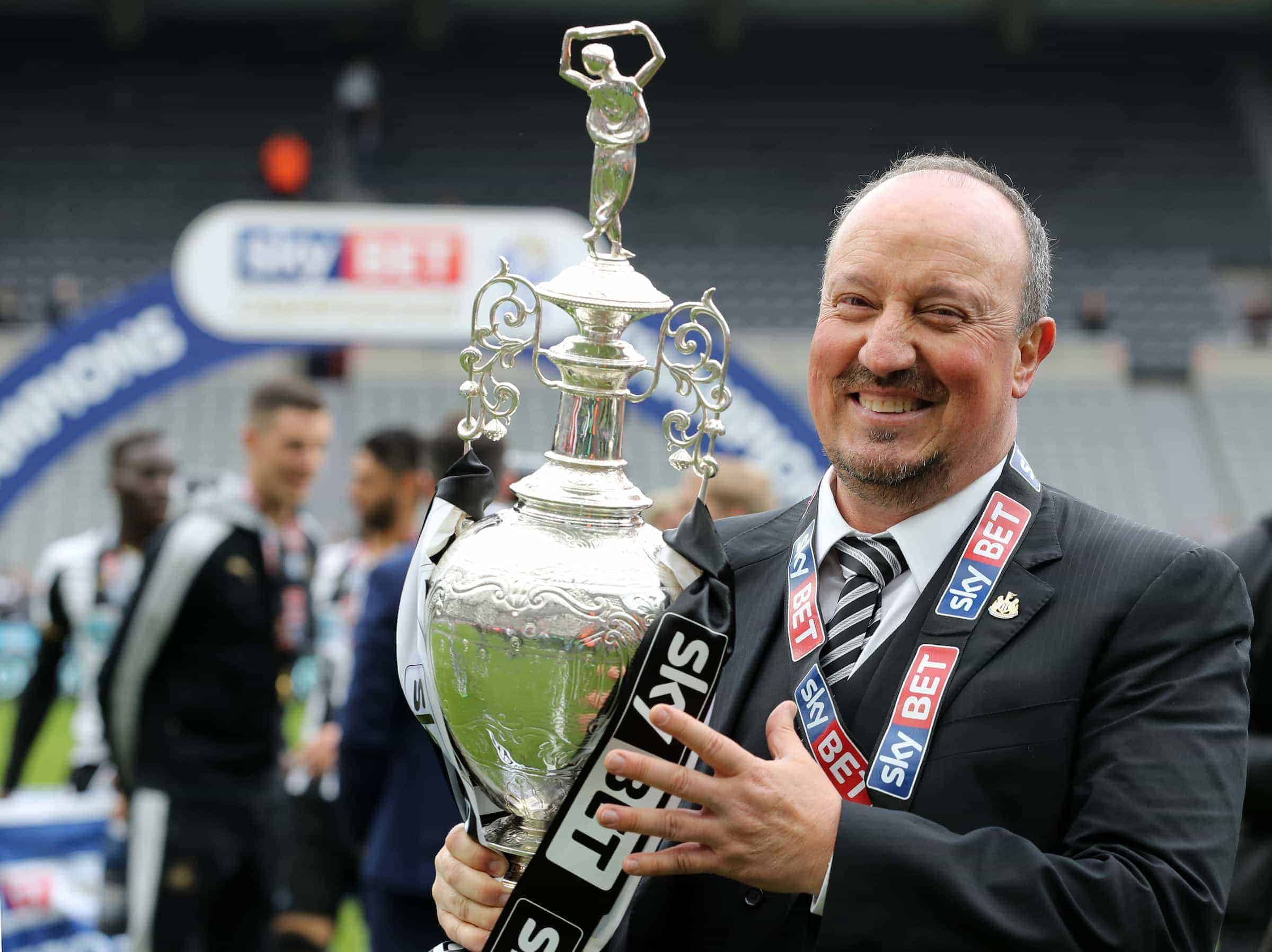 Newcastle United manager Rafa Benitez celebrates with the Sky Bet Championship trophy after the final whistle during the Sky Bet Championship match at St James' Park, Newcastle. (Photo: Owen Humphreys/PA Wire. )