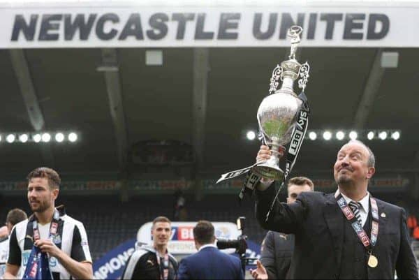 Newcastle United manager Rafa Benitez celebrates with the Sky Bet Championship trophy after the final whistle during the Sky Bet Championship match at St James' Park, Newcastle.