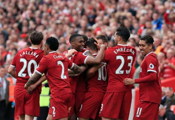 Liverpool's Philippe Coutinho (no. 10) celebrates scoring his side's second goal of the game with team-mates during the Premier League match at Anfield, Liverpool.