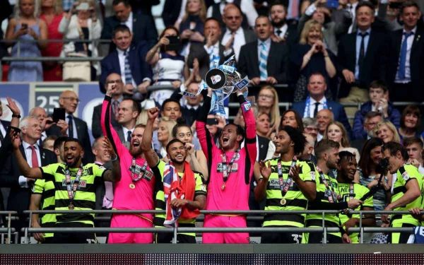 """Huddersfield Town goalkeeper Danny Ward lifts the trophy after winning the Sky Bet Championship play-off final at Wembley Stadium, London. PRESS ASSOCIATION Photo. Picture date: Monday May 29, 2017. See PA Story SOCCER Final. Photo credit should read: Nick Potts/PA Wire. RESTRICTIONS: EDITORIAL USE ONLY No use with unauthorised audio, video, data, fixture lists, club/league logos or """"live"""" services. Online in-match use limited to 75 images, no video emulation. No use in betting, games or single club/league/player publications."""