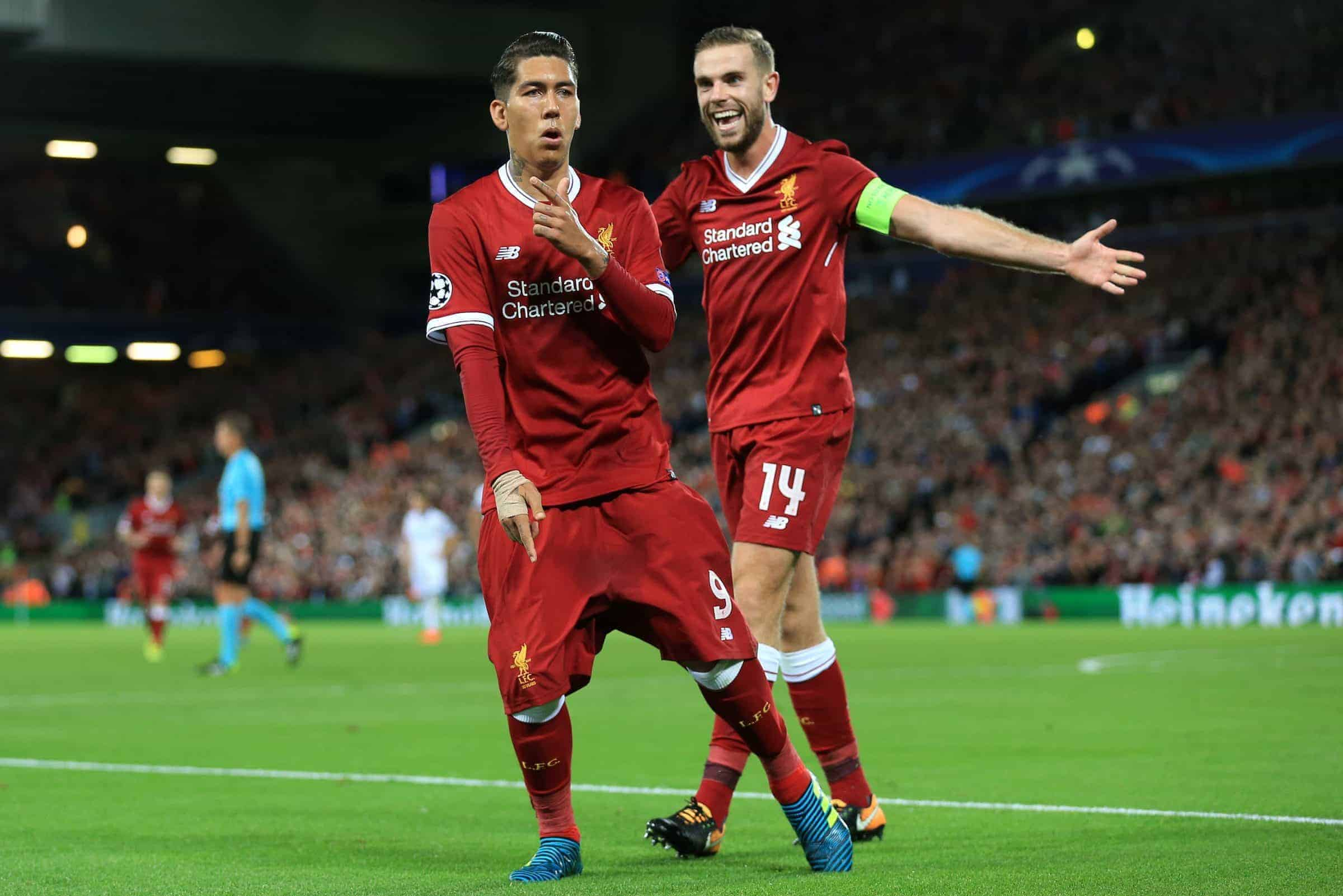 Liverpool's Roberto Firmino celebrates scoring his side's fourth goal of the game with team mate Liverpool's Jordan Henderson