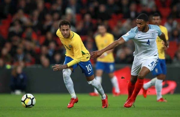 Brazil's Neymar (left) and England's Joe Gomez in action during the Bobby Moore Fund International match at Wembley Stadium, London.
