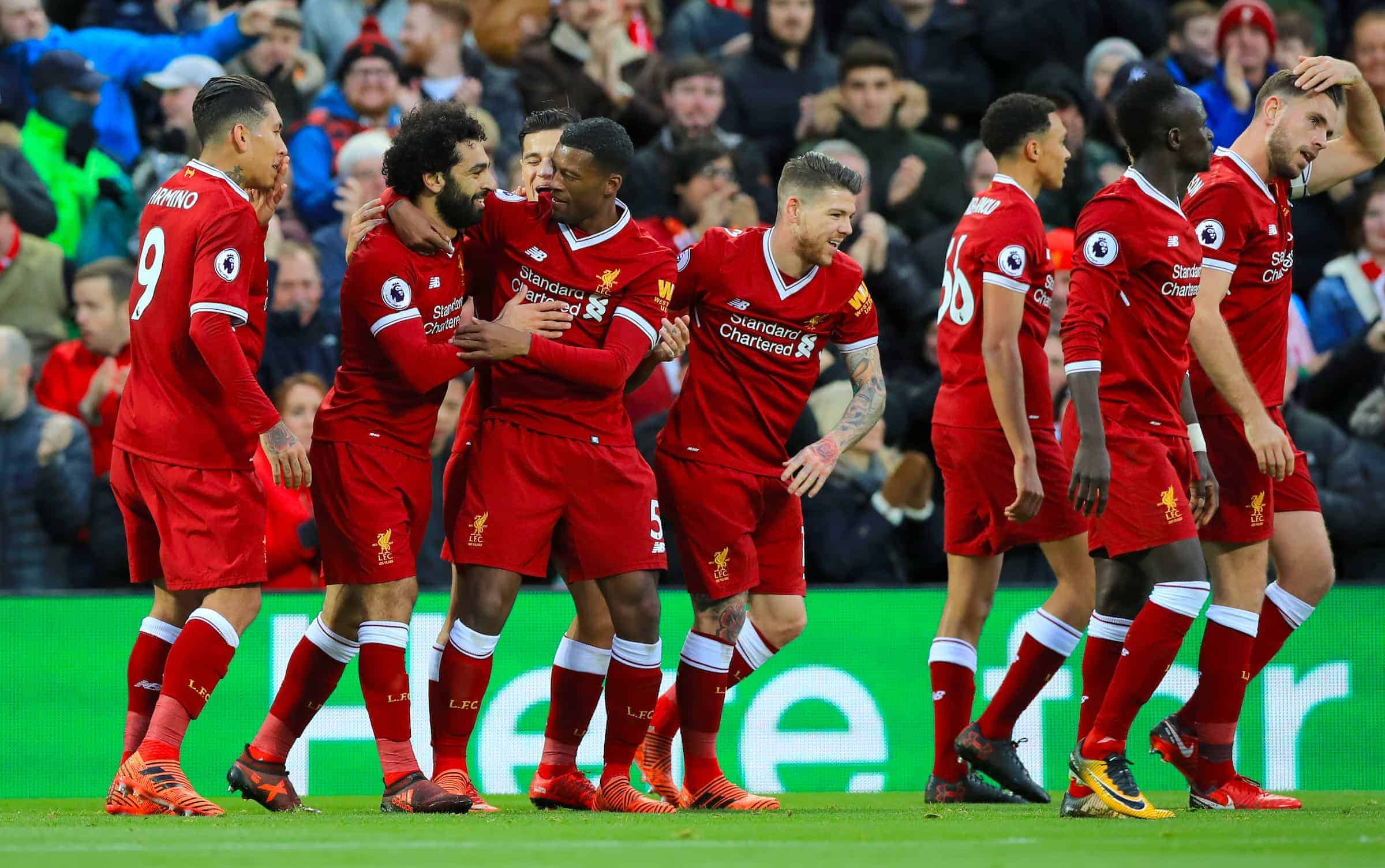 Liverpool's Mohamed Salah celebrates scoring his side's first goal of the game with team mates during the Premier League match at Anfield, Liverpool. (Peter Byrne/PA Wire.)