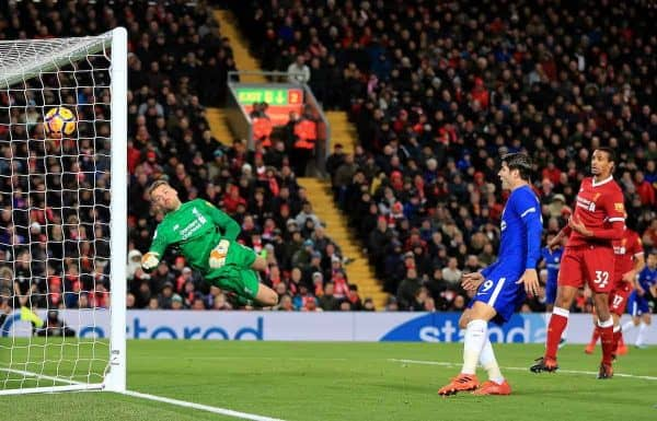 Liverpool goalkeeper Simon Mignolet dives in vain as Chelsea's Willian (hidden) scores his side's first goal during the Premier League match at Anfield, Liverpool.