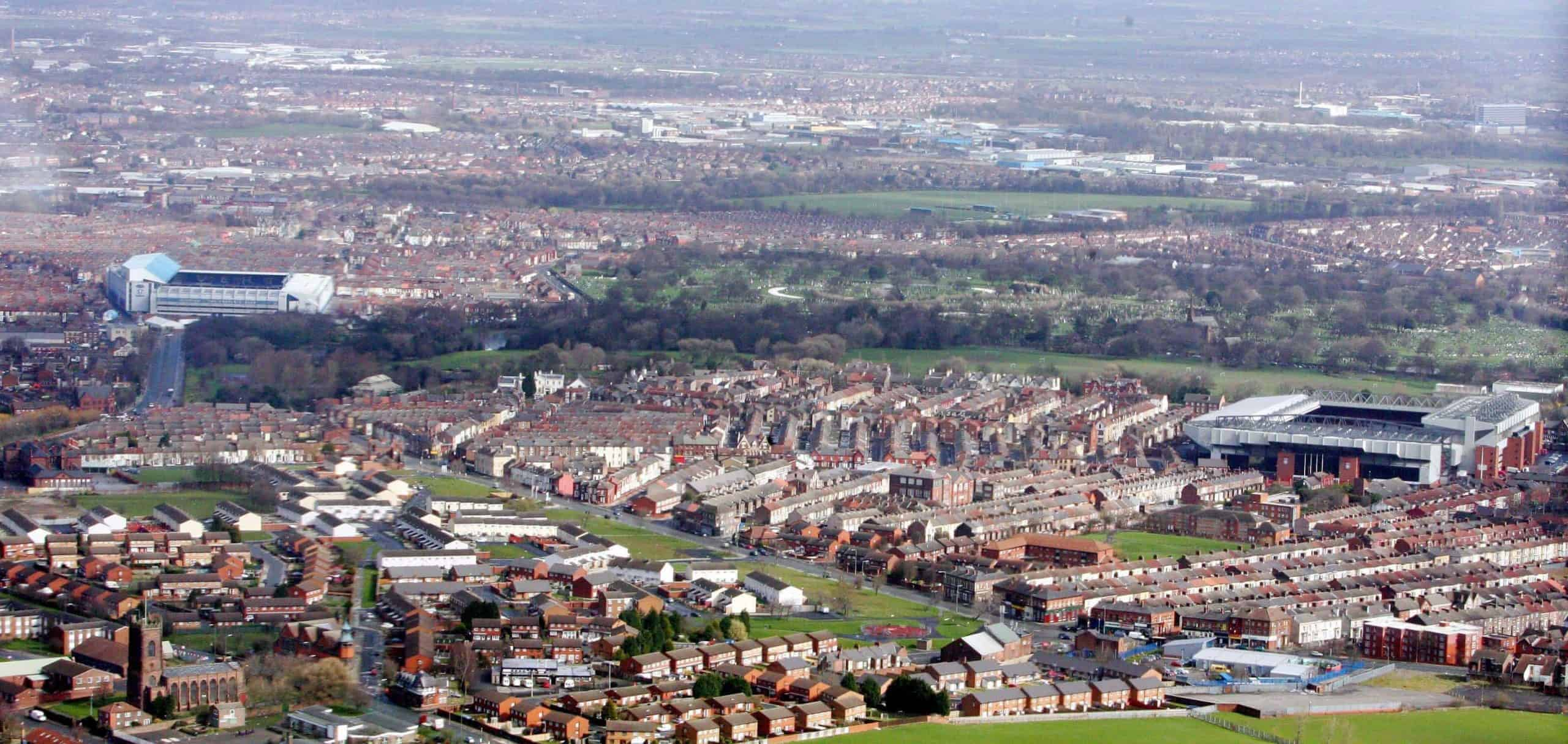 Aerial view of (right) Anfield Stadium home of Premier League Liverpool Football Club with Stanley Park behind. Stanley Park is the proposed new location for the new build stadium. and (Left) Goodison Park home of Everton Football Club (Picture by: Peter Byrne / PA Archive/Press Association Images)