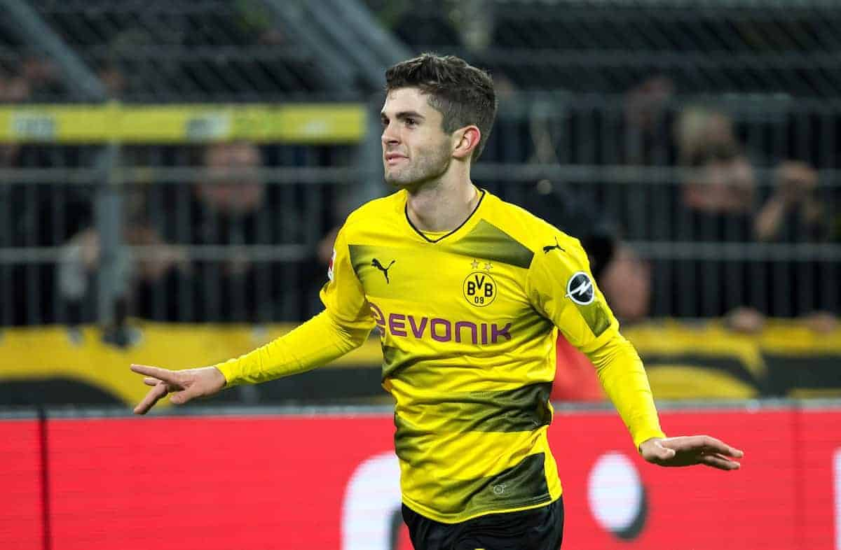 Dortmund's Christian Pulisic cheers over his 2-1 score during the German Bundesliga soccer match between Borussia Dortmund and 1899 Hoffenheim at the Signal Iduna Park in Dortmund, Germany, 16 December 2017. Photo: Guido Kirchner/dpa