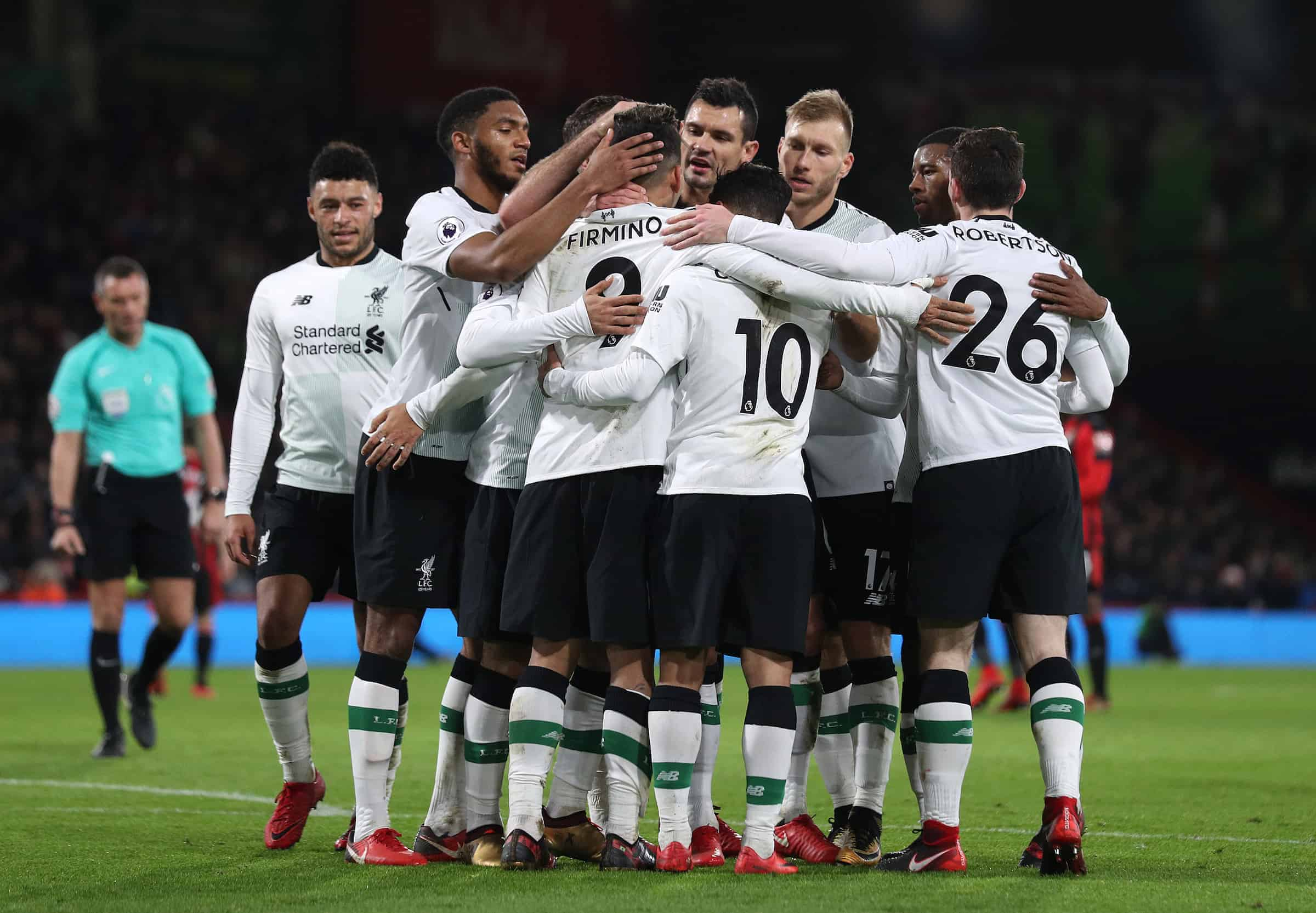 Liverpool's Roberto Firmino is mobbed by his team-mates after scoring his side's fourth goal during the Premier League match at the Vitality Stadium, Bournemouth.