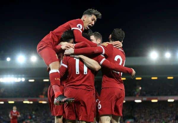 Liverpool's Mohamed Salah is mobbed by his team-mates as he celebrates scoring his side's second goal during the Premier League match at Anfield, Liverpool.