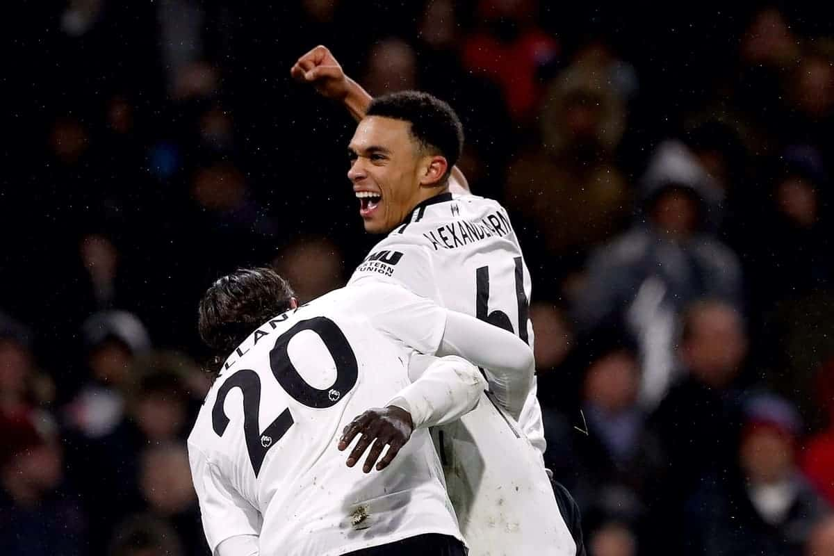 """Liverpool's Sadio Mane (obscured) celebrates scoring his side's first goal of the game with team-mates Liverpool's Trent Alexander-Arnold (right) and Liverpool's Adam Lallana (left) during the Premier League match at Turf Moor, Burnley. PRESS ASSOCIATION Photo. Picture date: Monday January 1, 2018. See PA story SOCCER Burnley. Photo credit should read: Martin Rickett/PA Wire. RESTRICTIONS: EDITORIAL USE ONLY No use with unauthorised audio, video, data, fixture lists, club/league logos or """"live"""" services. Online in-match use limited to 75 images, no video emulation. No use in betting, games or single club/league/player publications."""