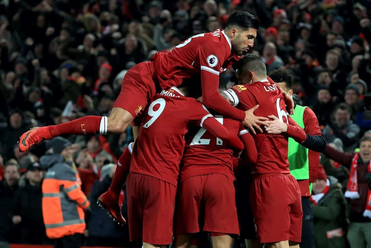 Liverpool's Sadio Mane (obscured) celebrates with team-mates including Liverpool's Emre Can (top) after scoring his side's third goal during the Premier League match at Anfield, Liverpool.