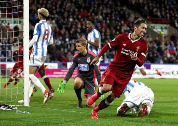 Liverpool's Roberto Firmino (right) celebrates scoring his side's second goal of the game during the Premier League match at the John Smith's Stadium, Huddersfield.