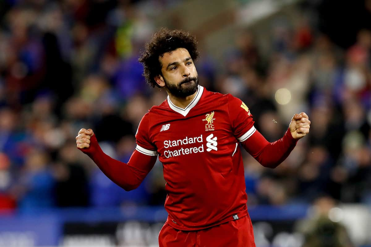Liverpool's Mohamed Salah celebrates scoring his side's third goal of the game during the Premier League match at the John Smith's Stadium, Huddersfield. (Martin Rickett/PA Wire.)