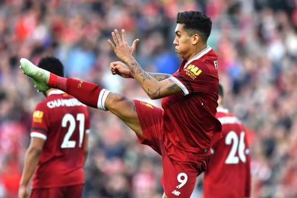 Liverpool's Roberto Firmino celebrates scoring his side's third goal of the game during the Premier League match at Anfield, Liverpool.