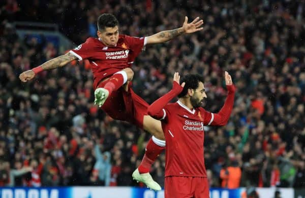 Liverpool's Mohamed Salah (right) celebrates scoring his side's second goal of the game with Roberto Firmino during the UEFA Champions League, Semi Final First Leg match at Anfield, Liverpool.
